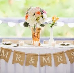 Love the burlap stamped banner for front of bride/grooms table.....easy to make & stays within the rustic theme.