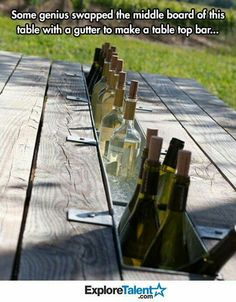 Guttering added to a slat removed from the table...perfect wine bar or even sodas!