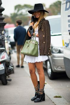 white minidress with a boucle Chanel jacket, black Chanel hat and adds black Chanel boots and Hermes bag