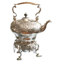 Sterling Rococo Hot Water Kettle With Stand And Burner  London, England  1901  A fully hall marked George III style hot water kettle with    repousse and engraved decoration.