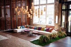 Beautiful colored pillows against the white sofa at the Free People Headquarters
