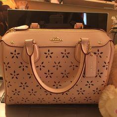 Coach bag New coach bag with tag , color is peach rose glitter . Coach Bags Mini Bags
