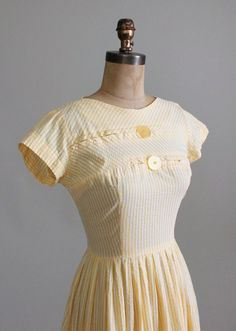 https://cdn.shopify.com/s/files/1/0229/0897/products/1950s_Yellow_Seersucker_Day_Dress-004_1024x1024.JPG?v=1432569857