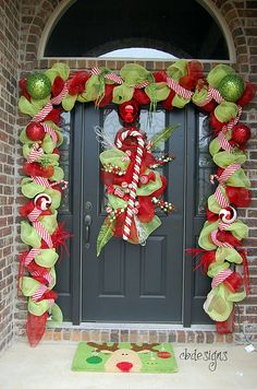 Thisis the merriest christmas porch ive ever seen! A Whole Bunch Of Christmas Porch Decorating Ideas - Christmas Decorating - Christmas Front Doors, Christmas Porch, Noel Christmas, Winter Christmas, All Things Christmas, Whimsical Christmas, Green Christmas, Christmas Entryway, Beautiful Christmas