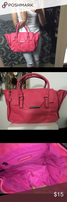 Hot pink handbag with gunmetal hardware Hot pink handbag with gunmetal details! Super spacious! Comes with shoulder strap (no pictured) small stain inside & back handles are slightly discolored from rubbing against jeans but other than that it's in great condition  the zippers can be open of closed (front & back) Height is 10in Length is 15.5-17.5in Bag Drop is 4in  Urban Expressions Bags Satchels
