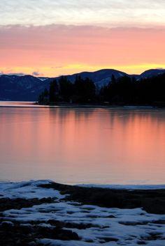 Sunset on a frozen Flathead Lake. Polson, Montana