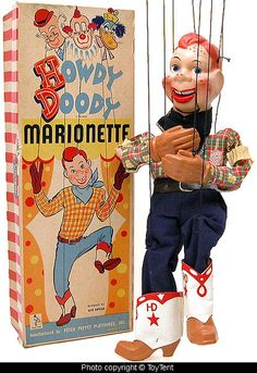 Howdy Doody Marionette early 1950's. I liked this show so much that I actually bought a porcelain Howdy Doody, complete with strings, and a porcelain Buffalo Bob. They're standing on my piano as I'm writing this.