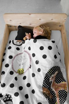 I love the bed and the black and white w/ deer comforter.