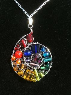 Rainbow Swirl  spiral wire wrap pendant by RootsandWingsDesigns