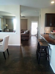 DIY Stained Concrete Floors. Not acid stained. This person only spent $300! I want stained concrete floors in my house!
