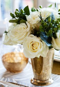 White roses in mint julep cup.