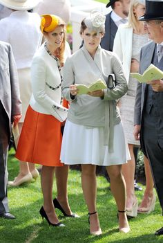 Princess Beatrice and Princess Eugenie attend Day 3 of Royal Ascot at Ascot Racecourse on June 19, 2014 in Ascot, England. (Photo by Stuart C. Wilson/Getty Images)