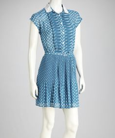 This shirt dress boasts a crocheted collar, polka dots a button-up top for a vintage look. The belt at the waist will flatter any figure.Sizenote: This item comes inJuniorssizing. Please refer to thesizechart.Includes dress and beltMeasurements (size M): 35'' long from high point of shoulder to hem100% polyesterHand wash; hang dryImported