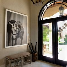Shelli Breidenbach Photography makes a classy addition to this barn foyer.