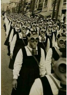 """This is one of the most haunting pictures I have ever seen. Schoolgirls in gas masks, WWII. And all I can think of is """"are you my mummy? Old Photos, Vintage Photos, Images Terrifiantes, John Thomas, Arte Obscura, Interesting History, Chernobyl, Vintage Photography, People Photography"""