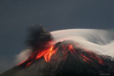 Volcano Tungurahua sometimes erupts spectacularly. The molten rock so hot it glows visibly pours down the sides of the 5,000-meter high Tungurahua, while a cloud of dark ash is seen being ejected toward the left. Wispy white clouds flow around the lava-lit peak, while a star-lit sky shines in the distance. The above image was captured in 2006 as ash fell around the adventurous photographer. Located in Ecuador, it has become active every 90 years. Image Credit & Copyright: Patrick Taschler