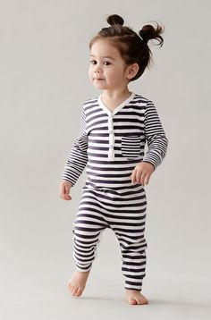 Designer Baby Clothes - Organic Cotton Baby Clothing - Broken Tricycle Stripe Unisex Coverall  Filled with stripy goodness, you'll love this gorgeous unisex baby coverall by Broken Tricycle!  Affordable organic cotton baby clothing at it's best!  Features snap close legs and front to make baby changing a breeze (or a little less difficult) - stylish and practical to boot!  #designerbabyclothes #organiccotton #unisexbabyclothes #babygirl #babyfashion #brokentricycle #littlebooteek
