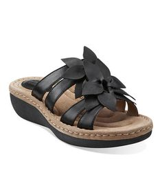 With its fun floral embellishments and premium leather craftsmanship, this sandal is super stylish. The low wedge and cushioned footbed ensure supreme comfort too. Pair with jeans or dresses for a winning look.