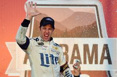 Brad Keselowski, driver of the #2 Miller Lite Ford, celebrates in victory lane after winning the Monster Energy NASCAR Cup Series Alabama 500 at Talladega Superspeedway on October 15, 2017 in Talladega, Alabama.