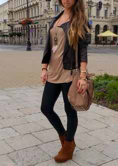 Make it more modest by changing the painted on leggings for black skinny jeans.  Can't go wrong with black and tan.   Love the slouchy bag!