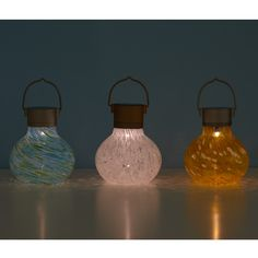 SOLAR TEALIGHTS - they provide an ambient glow that catches the bright colors of the swirled glass enclosures. Each light's silvery cap conceals a solar panel, which powers the long-lasting, energy-efficient LED bulb inside.