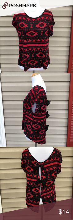 Nice women's black/red short sleeve knit blouse Very cute red/black Aztec print top , open back with black bows close.95% rayon 5% spandex, no snags, stains or holes Forever 21 Tops Blouses