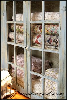 Creative Cain Cabin: CeCe Caldwell Blue Montana Sky chalk paint. Vintage quilts. Chicken wire doors.