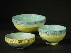 Brian Jewett: Ticket Bowls. A form of paper basket-making. Made by winding multiple rolls of tickets into one disk, shaping and sealing.