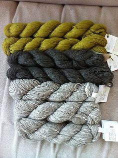 color scheme for living room: chartreuse, dark blue gray, gray plus emerald and cream