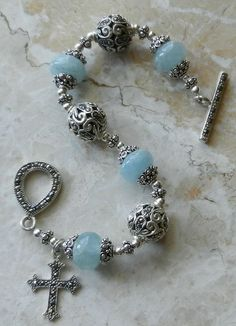 This is a bracelet I made.  Genuine aquamarine and marcasite bracelet religious bracelet available at www.queenofpeace-rosaries.com
