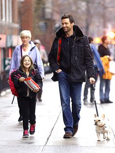 Hugh Jackman The actor and his 7-year-old daughter Ava share a laugh as they walk their French bulldog Dali in New York City.