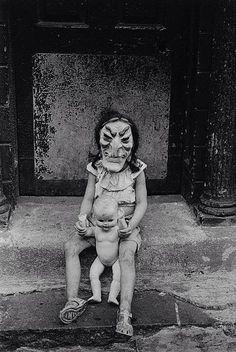 Diane Arbus, Masked Child with a Doll, N.Y.C., 1961