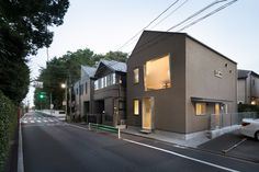 Completed in 2016 in Tokyo, Japan. Images by Takumi Ota. A small wood structure house with an office floor on the ground level,standing on a standing on a 49.5sqm building area within the 100 sqm site. To...