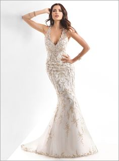 Designer:  Maggie Sottero 'Blakely'  Description: The lavish embroidery and sparkling beads of this fit and flare gown capture the dramatic flair of a bygone era. Finished with scalloped illusion neckline, and button over zipper back closure. Division: Haute Couture  $1529.00