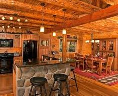 Complete with wood walls and ceiling, along with dark wood beams, this kitchen room is wonderfully cozy and rustic in design. Cabin Interior Design, House Design, Interior Ideas, Best Living Room Design, Living Room Designs, House In The Woods, My House, Residential Log Cabins, Log Home Floor Plans