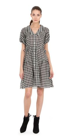 This lightweight Italian tissue crepe dress has an easy feel that's perfect for summer. - V neckline with double collar - Drawstring waist and sleeve detail - B
