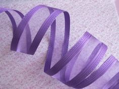 This listing is for 5 Yards of Decorative Ribbon  Color: Purple (Grape)  Wired edge  Approximately 1 1/2 wide.  Price is for 5 yards. ( Sells in