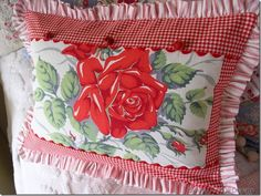Pillow using a piece of a vintage tablecloth for the center piece. Judy~