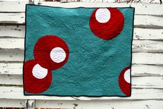 modern quilt.....these remind me of olives in a martini!