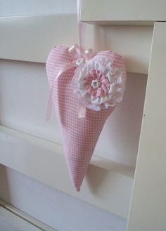 Pink check heart with yoyo and bow Would be great for the girly girl for her room.