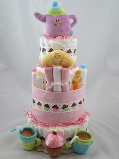 Tea anyone? What an adorable gift for a baby girl. This diaper cake is jammed packed with all kinds of goodies!  Love the Blue River Baby Shoppe designs.