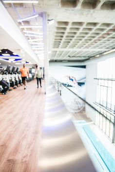 A frameless glass balustrade was designed for this walkway. To ensure the safety of the gym members, a professional engineer was consulted to achieve a system that would withstand human impact.
