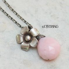 """A Beautiful, natural, pink Peruvian Opal that I wrapped in sterling wire and a handmade silver flower drop from a sterling chain that closes with a lobster claw clasp. I have oxidized most of the silver to create the vintage patina. All metal is .925-.990 sterling and fine silver. Peruvian Opal - approx. 5\/8"""" long Silver Flower - slightly over 1\/2"""" in diameter Total Drop - almost 1""""  This One Of A Kind necklace is approx. 19"""" long, and can be shortened, if requested, for no additional…"""