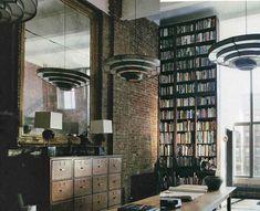 brick wall, giant mirror, tall book case
