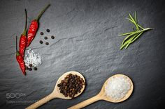 Chili with black pepper and salt on rustic stone background. Ove by dziewul