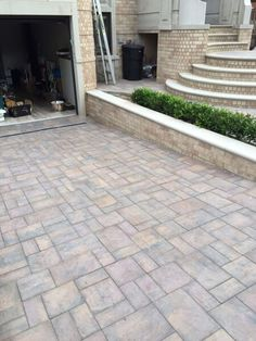 Complement a new Cambridge Pavingstone driveway with plants and flowers on either side. Plants and flowers complement paving stone patterns wonderfully!