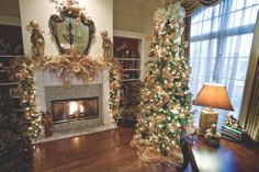 Homes for the Holidays: Cathye and Rick Amoses' office tree decorated in gold and white, featuring angels and crowns that Rick has collected for over 10 years. Photo by Neil Ladner for Mississippi Magazine.