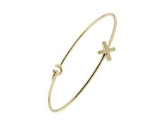 The solid gold Kiss bangle. A bangle of love.
