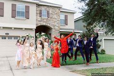 Fun wedding party photography, light pink bridesmaid dresses