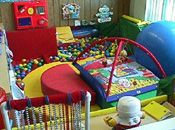 an enclosed play area with mats and interactive toys